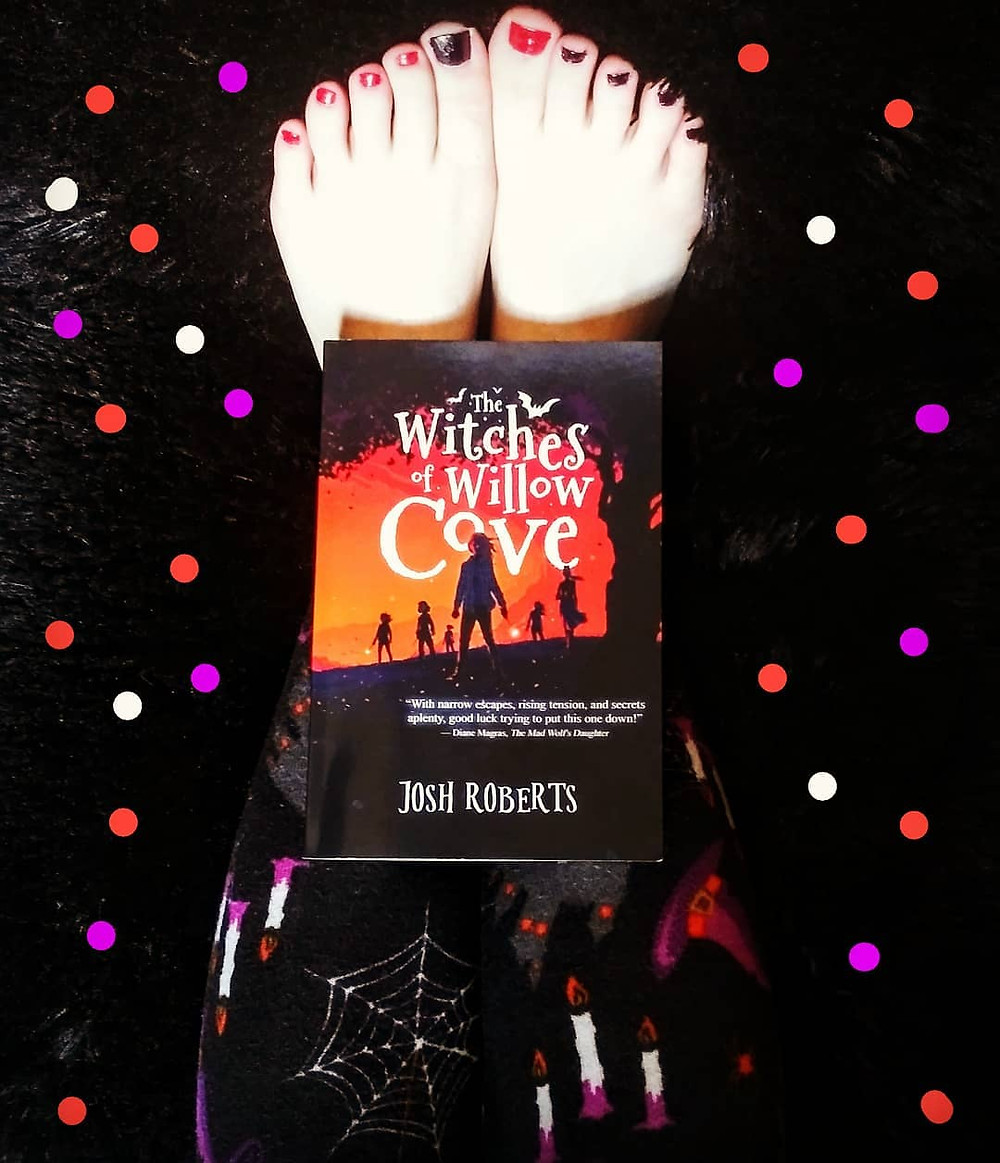 the witches of willow cove book, witchy leggings, and halloween nail polish