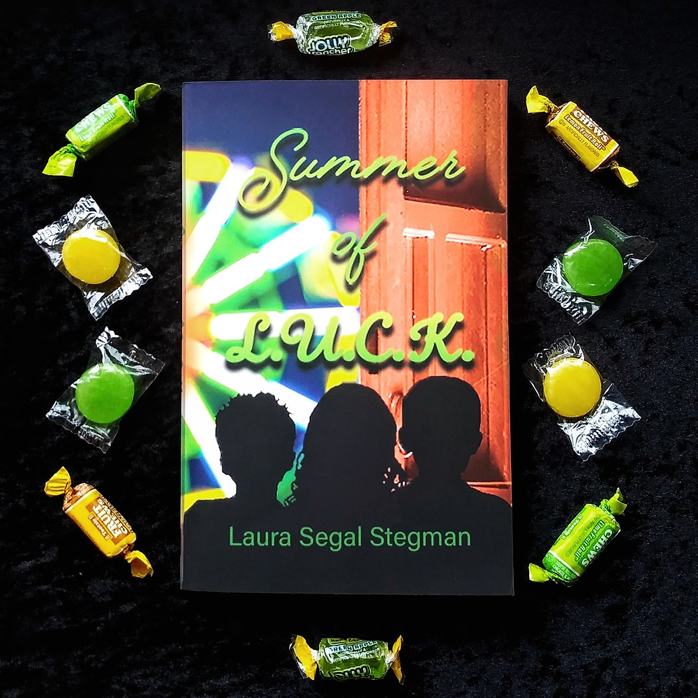 summer of l.u.c.k. book with green and yellow candy