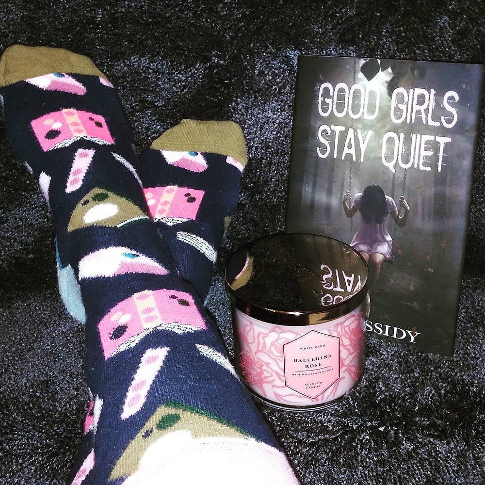 Book socks and Good Girls Stay Quiet book with pink candle