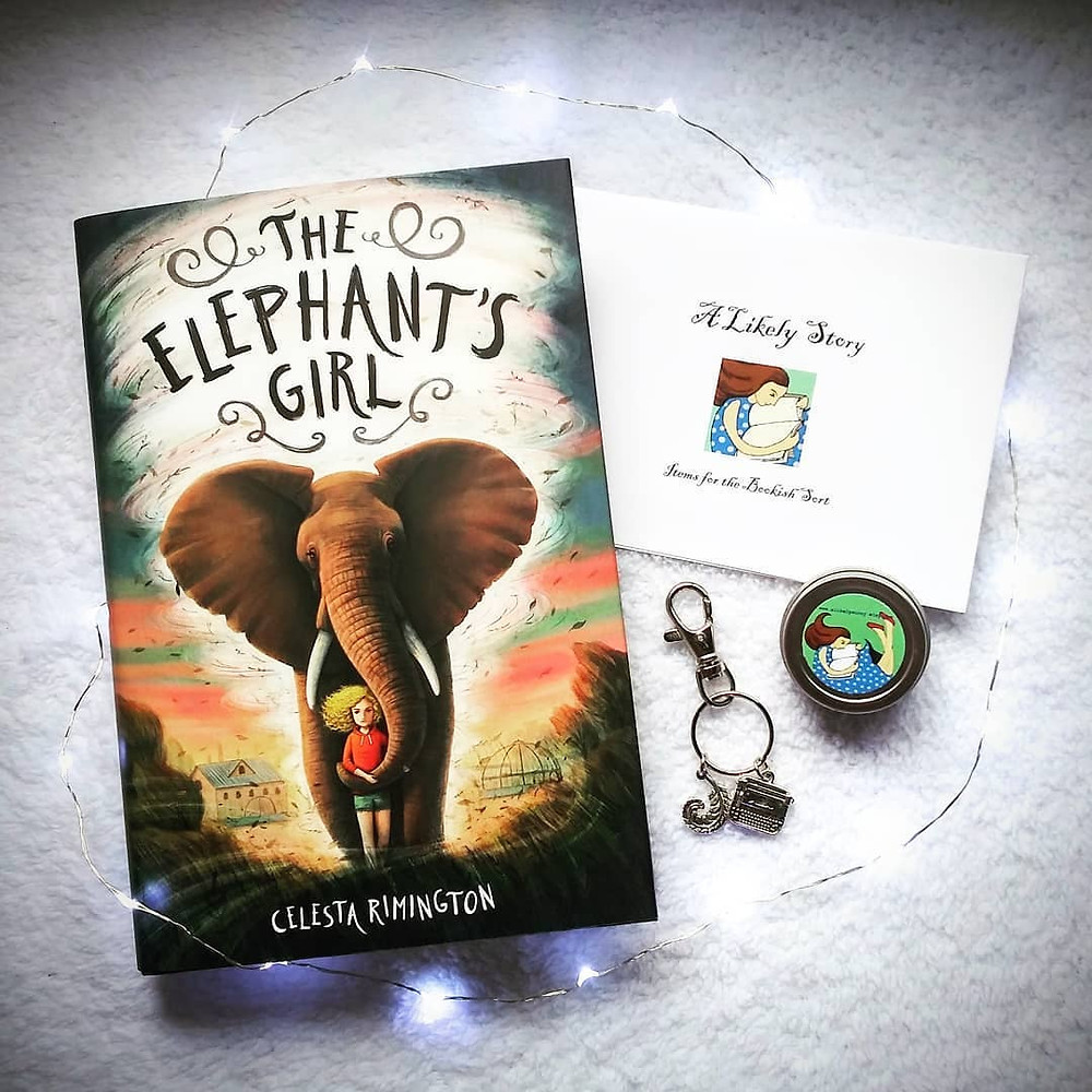 the elephant's girl book, fairy lights, and typewriter keychain