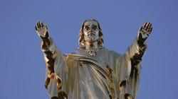 Domain and Range still of golden jesus statue