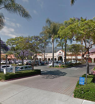 View of Santa Barbara Plaza entrance from Milpas St and parking lot with Petco in the background.