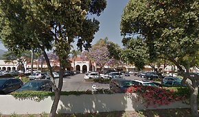 View of Santa Barbara Plaza parking lot from Milpas St with Trader Joe's in background.