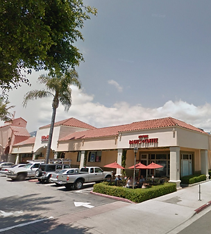 Side view of Santa Barbara Plaza with Rite Aid and Jack's Famous Bagels and Coffee.