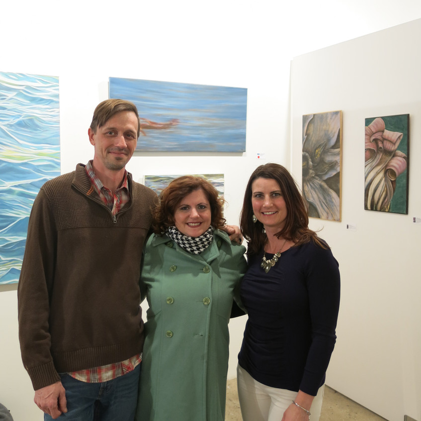 Artist Alicia Cully with her works
