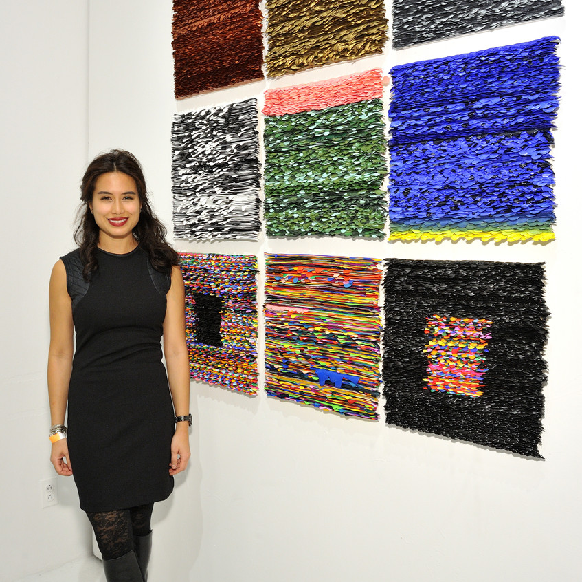 Artist Monica Delgrado with her work