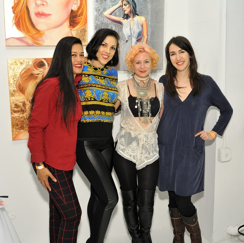 Artist Ginger Del Ray with her works