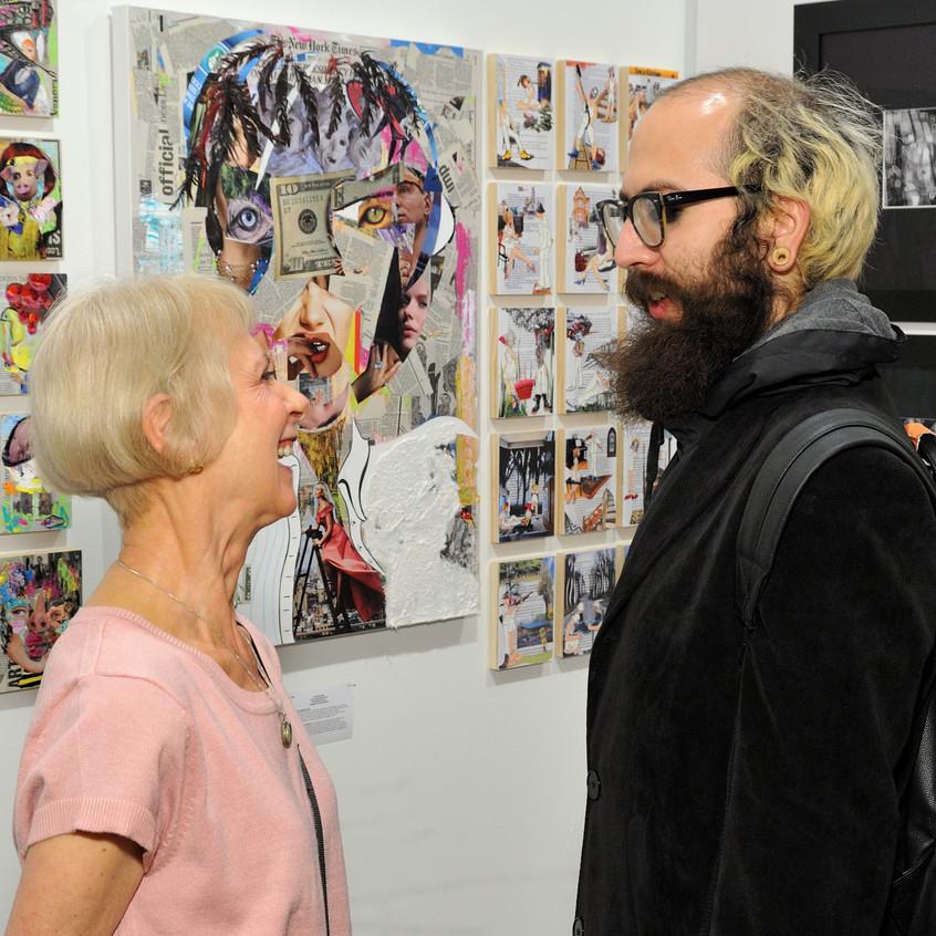 Artist Carol Scavotto with her works