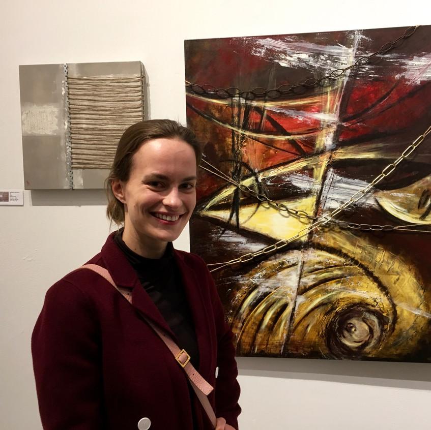 Artist Marina Viatkina with her work