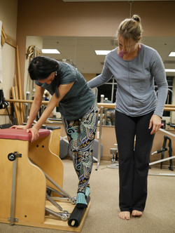 teaching side pull up on the chair, pilates chair, pilates rehab, client, patient, physical therapis
