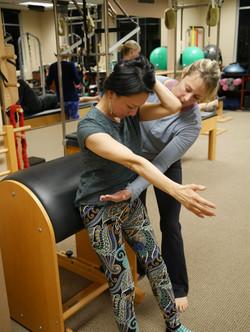 teaching ladder barrel mobility exercises, pilates, spinal flexion
