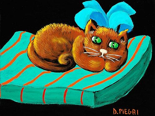 Gatto rosso con cuscino verde