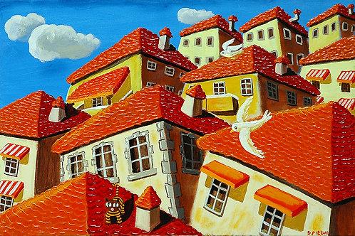 Colomba che vola sopra i tetti di Cortona