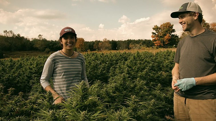 Darryl and Haeli posing in front of this year's hemp crop.