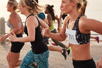 women running triathlon