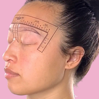 Forehead ruler pink background.png