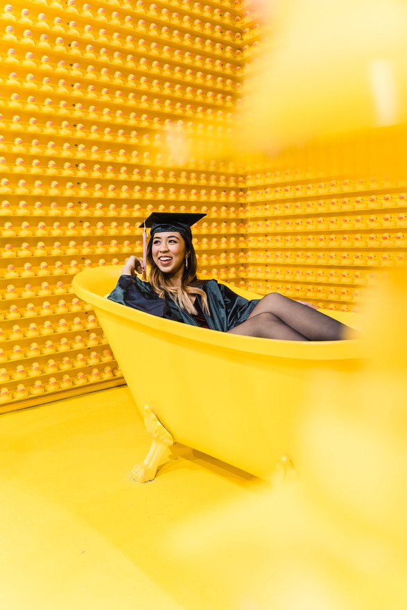 Graduate in a Yellow Tub