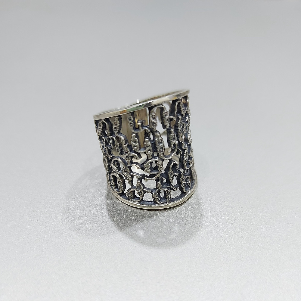 Silver ring featuring Armenian alphabet letters