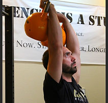 Gray Godwin Personal Trainer does Kettlebells in his private Austin gym