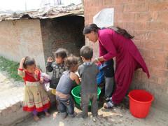 Children washing their hands befor lunch