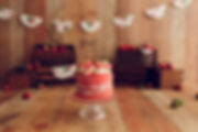 Strawberry cake smash, banner, crates, cake.