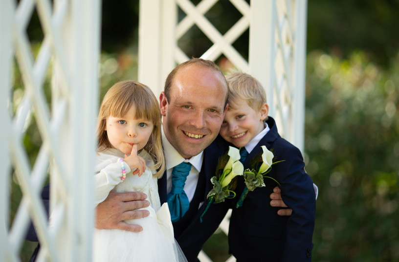 Groom with son and niece wedding photography