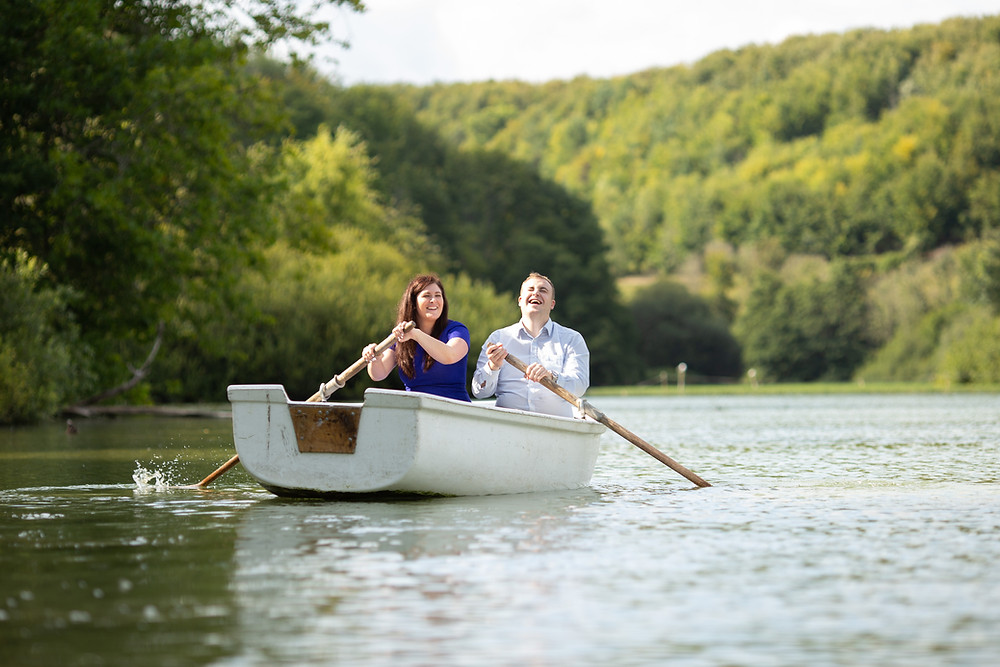 wedding couple on Swan lake Arundel boat during west Sussex photoshoot