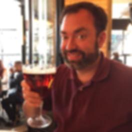 Drew Vahrenkamp drinking a beer in Paris