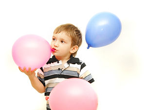 kid with balloons.jpeg