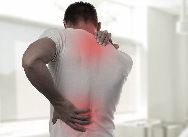 Muscular Man suffering from back and nec