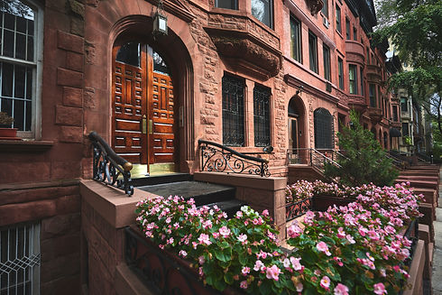 A view of a historic brownstone on a sun