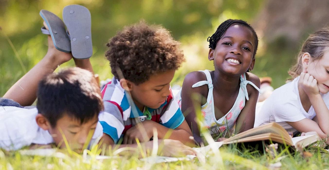 Kids Reading outside wide cut.jpg