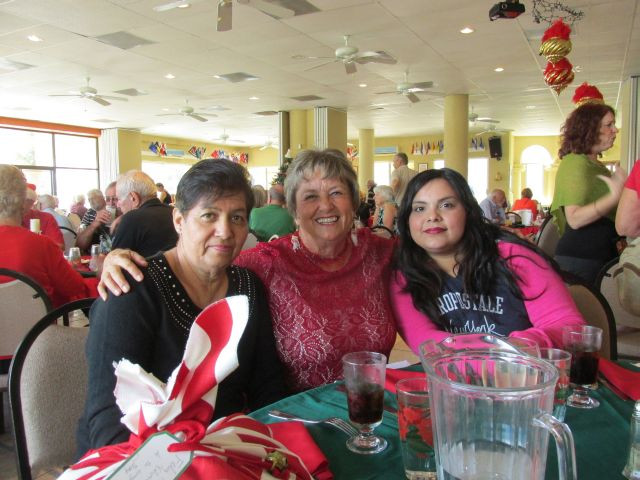 Terry Challis, her student Paola, and Paola's mom