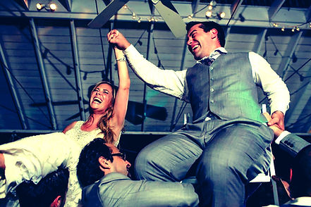 Bride & Groom lifted on chairs
