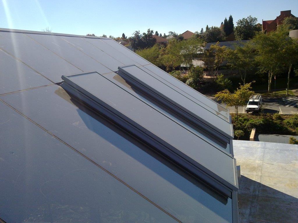 Flush Glazed Ridge Pyramid with two Standard Rainbowlite Flat Glass Openable Skylights