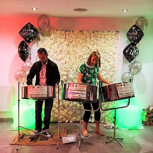 Rebekah and Graham performing at a party