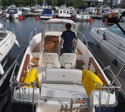 Snap Kayaks On Motorboat