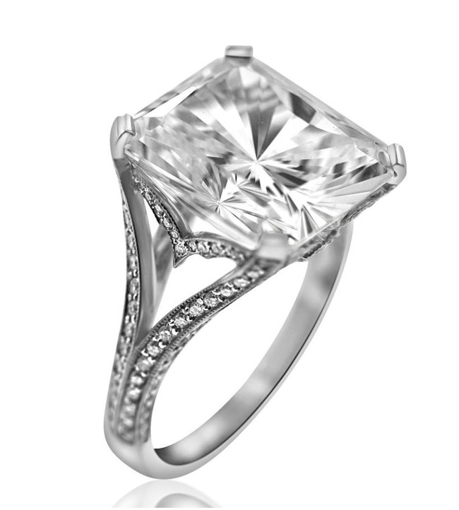 Asscher Cut Triple Diamond Engagement Ring   3.10 carat asscher cut Diamond surrounded by two Diamonds totaling in 1.08 carats, with another .31 carats of Diamonds around the band, set in Platinum.  