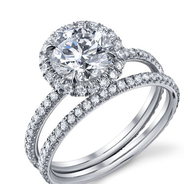 Round cut Halo Mounting   Hand made with 73 scalloped pave set melee Diamonds totaling in .56 carats and set in Platinum, this classic round halo engagement ring is waiting for us to find your perfect center stone.  Contact us for help in choosing a center stone
