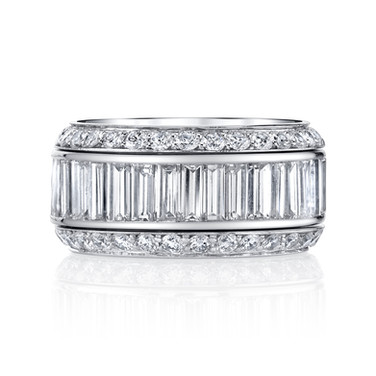 Diamond Baguette Eternity Band  Baguette Diamonds come together in Platinum to create this unique eternity band.  (Outer eternity bands not included)  Size: 5.5