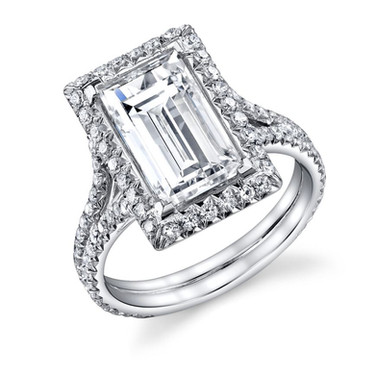 Baguette Halo Ring Hand crafted with anGIA certified J VS1 4.07 carat Baguette Cut Diamond surrounded by 109 Diamonds totaling in .88 carats, set in Platinum.  Size: 6.25  