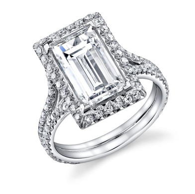 Baguette Halo Ring Hand crafted with anGIA certified J VS1 4.07 carat Baguette Cut Diamond surrounded by 109 Diamonds totaling in .88 carats, set in Platinum.  Size: 6.25  ​