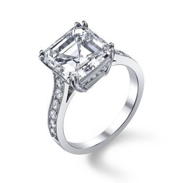 Asscher Cut Diamond Ring Hand crafted with a GIA certified 5.41 carat Asscher cut Diamond surrounded by 24 more Diamonds totaling in .48 carats, set in Platinum.  Size: 6.5