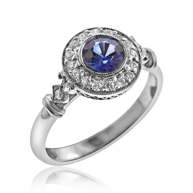 Round Sapphire Diamond Halo Ring  .5 carat Sapphire in a .18 carat Diamond halo, set in Platinum
