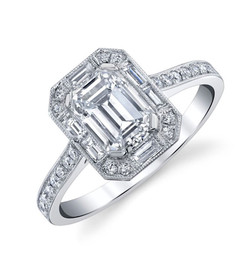 Emerald Cut Halo Ring   Hand crafted with a 1.23 carat Emerald Cut Diamond surrounded by 6 Baguette Diamonds totaling in .2 carats and 28 round Diamonds totaling in .24 carats, set in Platinum.  Size: 6.25  