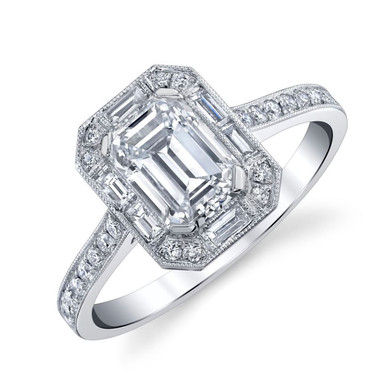 Emerald Cut Halo Ring ​  Hand crafted with a 1.23 carat Emerald Cut Diamond surrounded by 6 Baguette Diamonds totaling in .2 carats and 28 round Diamonds totaling in .24 carats, set in Platinum.  Size: 6.25  ​