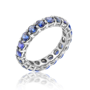 Sapphire Eternity Band  3.11 carats of round Sapphires, set in Platinum.  Size 5 and 3/4