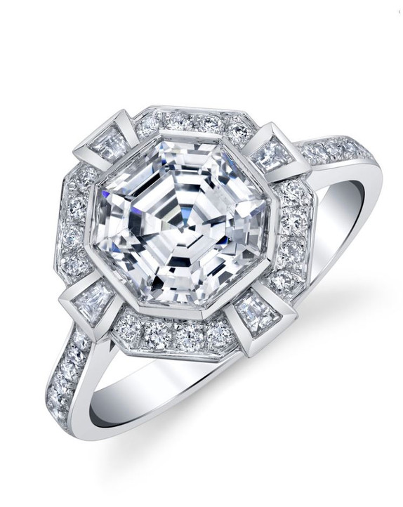 Square Ascher Cut Halo Mounting Hand made with 40 round and baguette diamonds, totaling in .55 carats,set in 14k white gold, this unique octagon halo engagement ring is waiting for us to find your perfect center stone.  Contact us for help in choosing a stone: