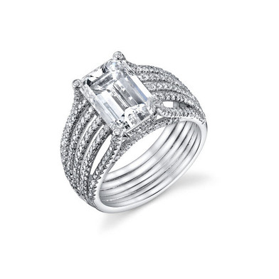 5 Band Emerald Cut Ring Hand crafted with a GIA certified 4.04 carat Emerald cut Diamond surrounded by 202 more Diamonds totaling in .60 carats, set in Platinum.  Size: 6.25