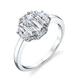 Emerald Cut, Double Half Moon Ring   Hand crafted with a 1.25carat Emerald Cut Diamond surrounded by 2 Half Moon Diamonds totaling in .35 carats, set in Platinum.  Size: 6